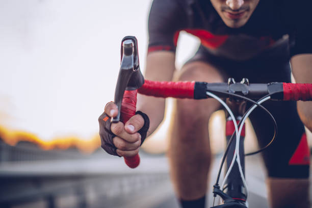 man cycling outdoors - cycling stock photos and pictures