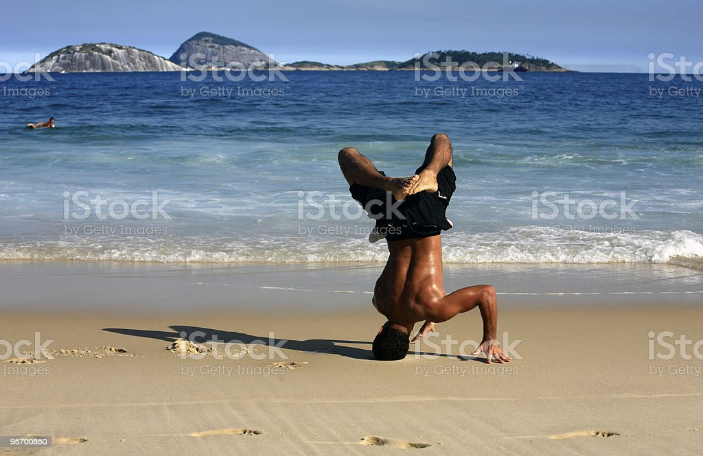 man dancing capoeira on a beach in brazil stock photo