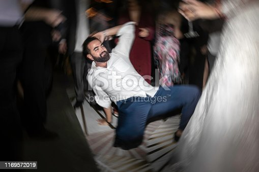 Man dancing in the dance floor during party