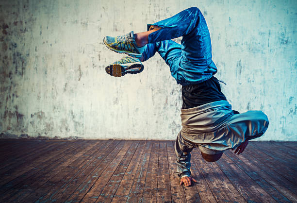 Man dancing on wall background stock photo