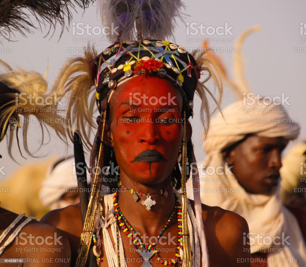 Man dancing Yaake dance and sing at Guerewol festival in InGall village, Agadez, Niger stock photo