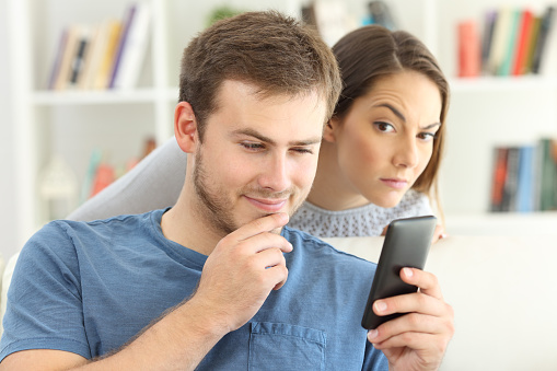 Man Dating On Line And Girlfriend Spying Stock Photo - Download Image Now