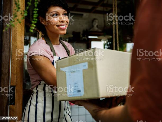 Man deliver mail box to woman in front of stop picture id658510400?b=1&k=6&m=658510400&s=612x612&h=pwaihpo9 njrrs0fgseip1el16zaav7ypepiloqxtj8=