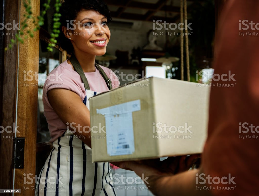 Man Deliver Mail Box to Woman in front of Stop stock photo