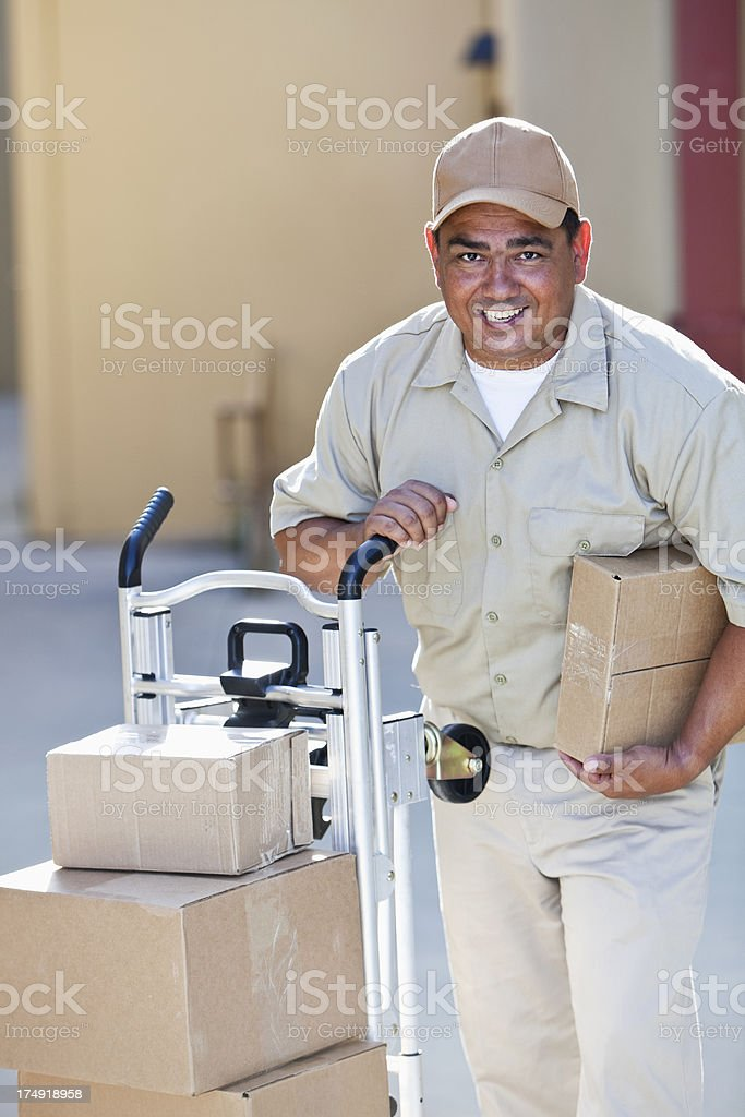 Man delivering packages stock photo