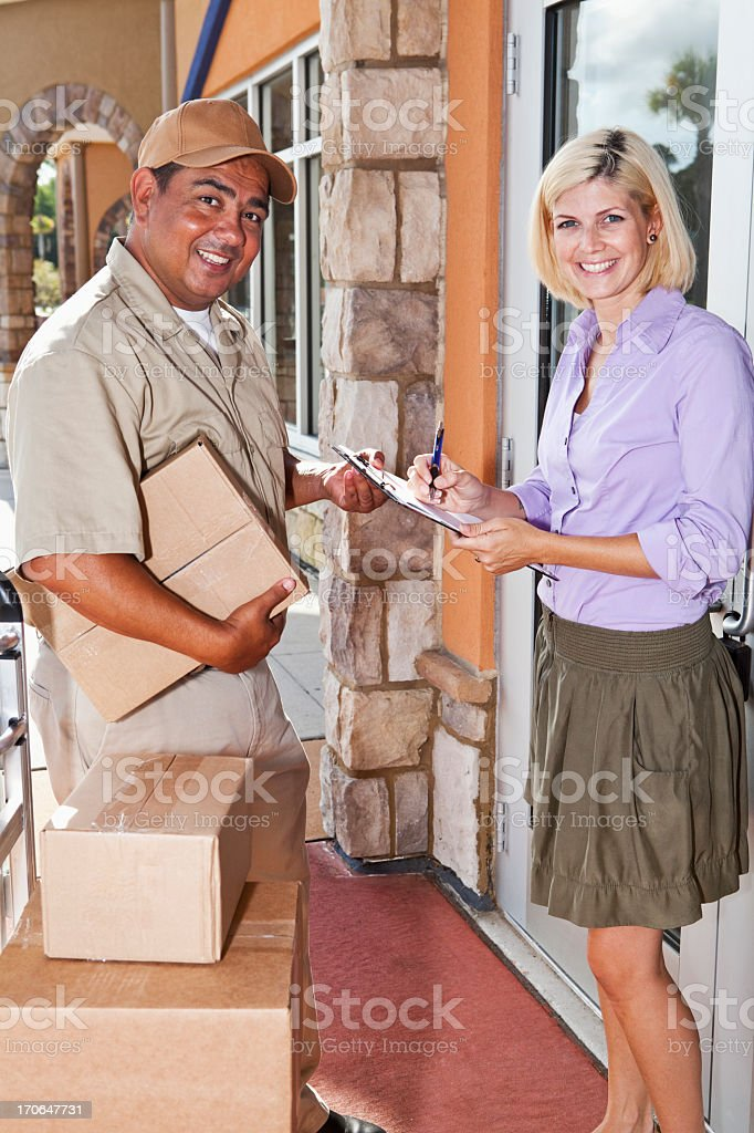 Man delivering packages to customer stock photo