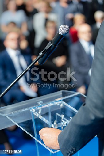 854811490 istock photo Man delivering speech 1071149808