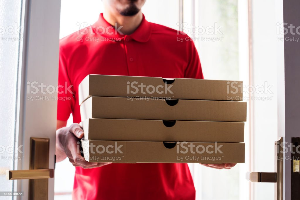 Man delivery pizza to customer stock photo