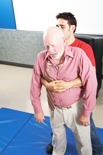 Heimlich Maneuver High Resolution Stock Photography and