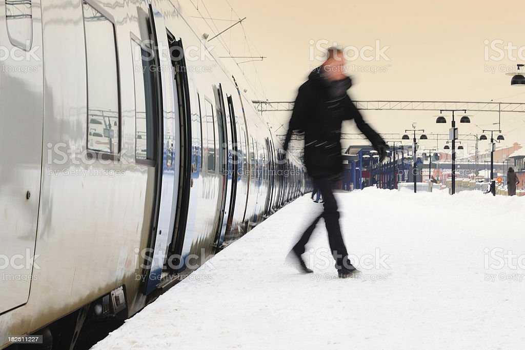Man departing from commuter train royalty-free stock photo