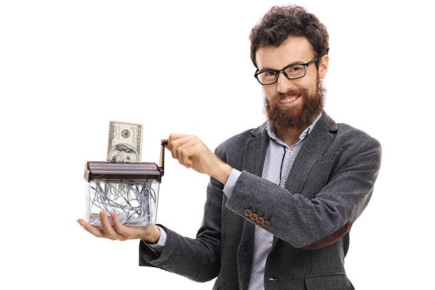 Man destroying a dollar banknote in a paper shredder Man destroying a dollar banknote in a paper shredder isolated on white background money to burn stock pictures, royalty-free photos & images