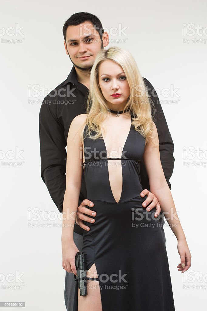69df9b502 Man detective agent criminal and sexy spy woman with gun. - Stock image .