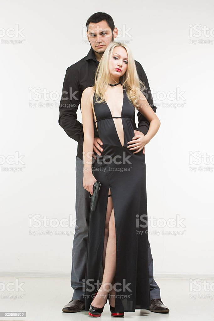 b94babaeb Man detective agent criminal and sexy spy woman with gun. royalty-free  stock photo