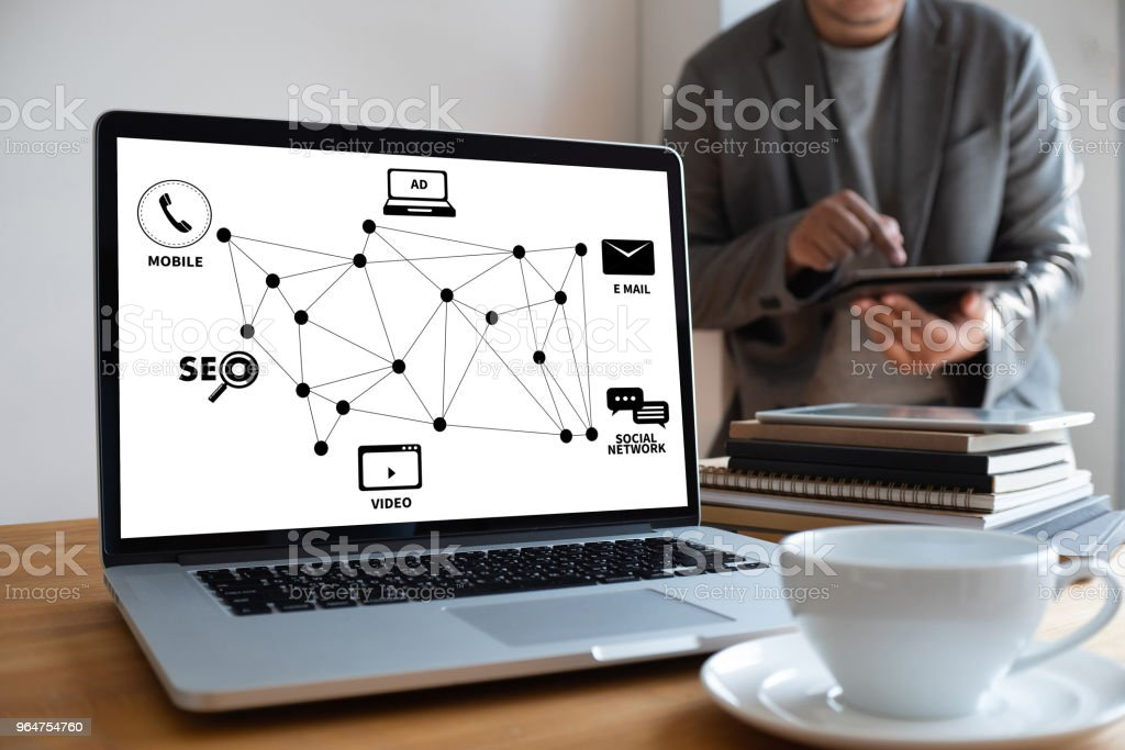 SEO  man DIGITAL MARKETING new startup project MILLENNIALS Business team hands at work with financial reports and a laptop royalty-free stock photo