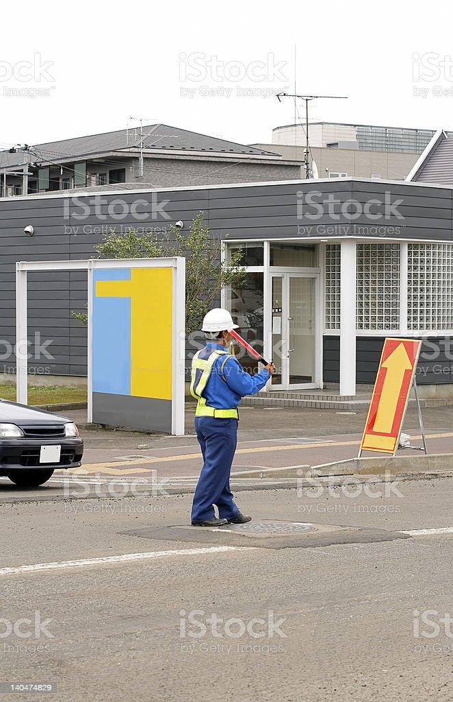 Man directing traffic 2 royalty-free stock photo