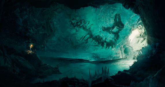 Man (explorer) discovering a large frozen fossil inside a beautiful ice cave
