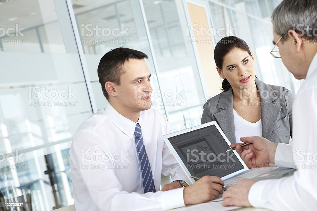 Man discussing chart results with employees royalty-free stock photo