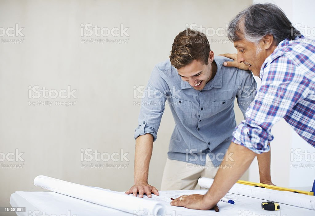 Man discussing home renovation plan with contractor royalty-free stock photo