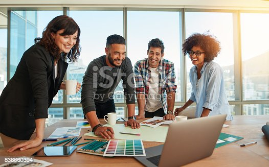 848290020istockphoto Man discussing new designs and color scheme with colleagues 836660394