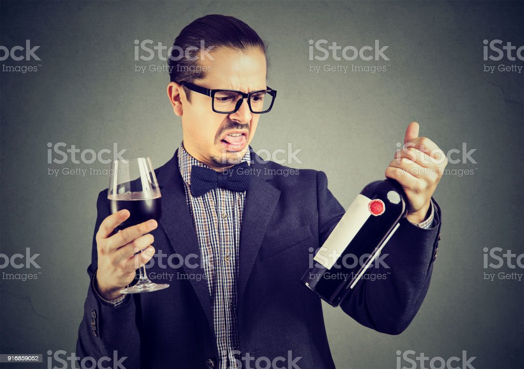 Man dissatisfied with wine quality stock photo