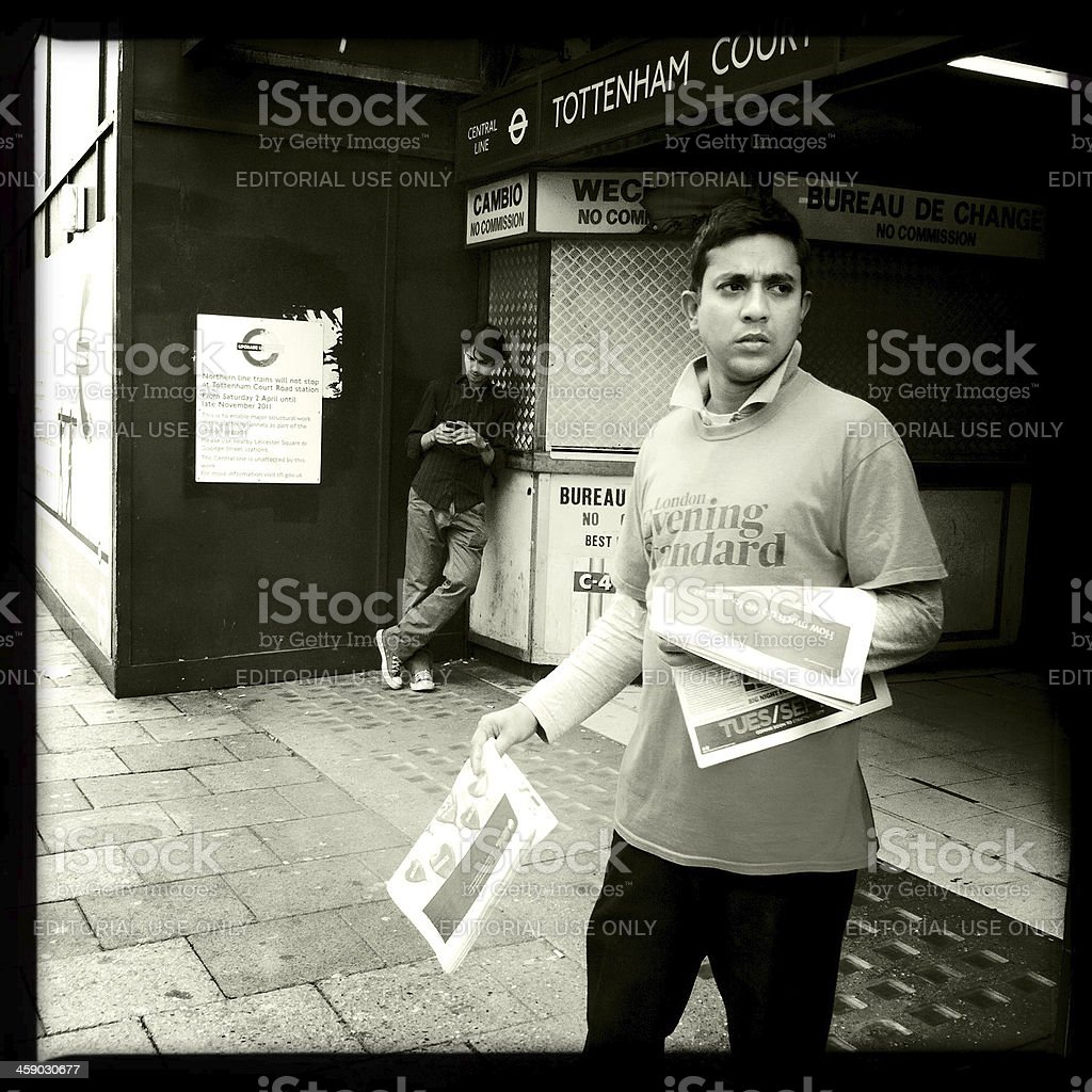 Man Distributing The Evening Standard in London stock photo
