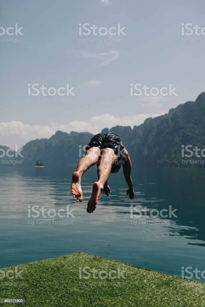Man Diving Into The Water Stock Photo - Download Image Now