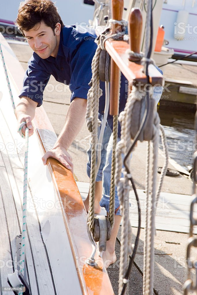 Man Docking Sailboat stock photo