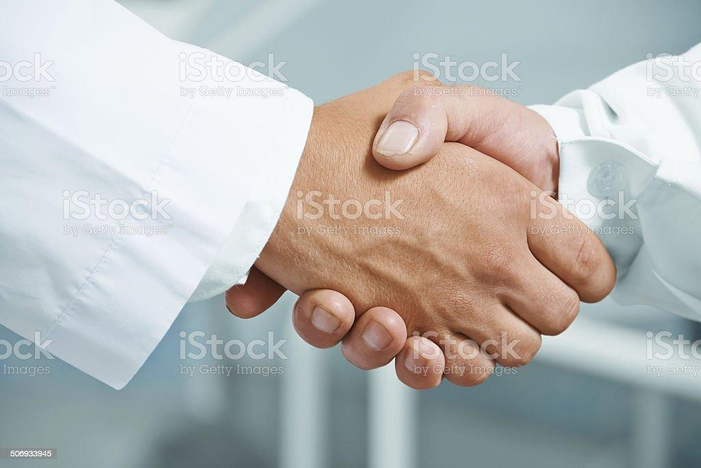 Man doctor shakes hand stock photo