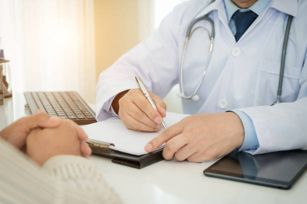 man doctors and patient are discussing something for consultation. medical doctor working in hospital writing a prescription, healthcare and medically concept - prostate exam stock pictures, royalty-free photos & images