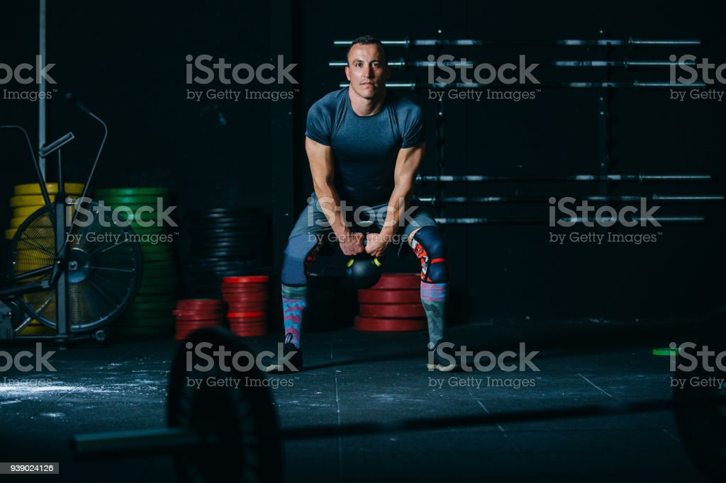 Man Does Kettlebell Swing Exercise Stock Photo & More Pictures of ...