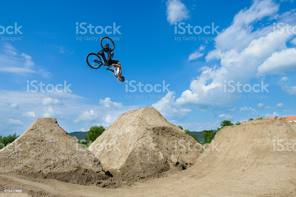 Man Does Somersaults on Bike stock photo