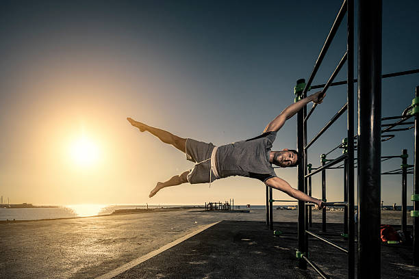 Man doing a flag figure part of his calisthenics routine stock photo