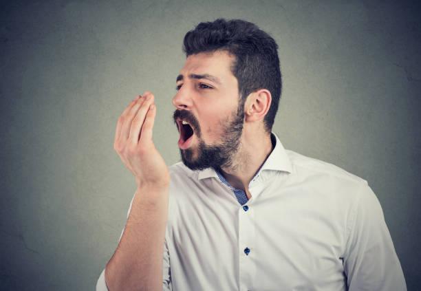 man doing a hand breath test stock photo