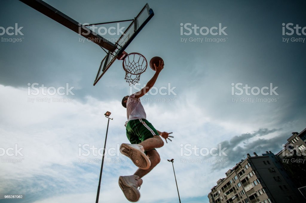Man doing a slam dunk royalty-free stock photo