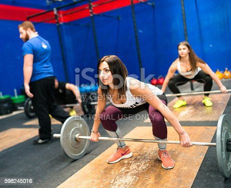 610237160istockphoto man doing a strong training gym weightlifting 598245016