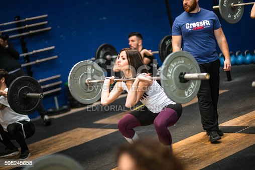 610237160istockphoto man doing a strong training gym weightlifting 598245658