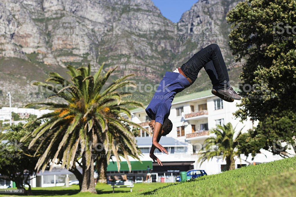 Man Doing Backward Somersault stock photo