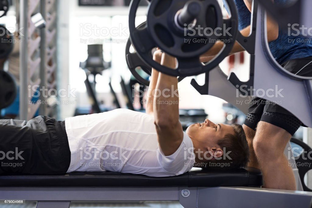 Man doing bench press stock photo