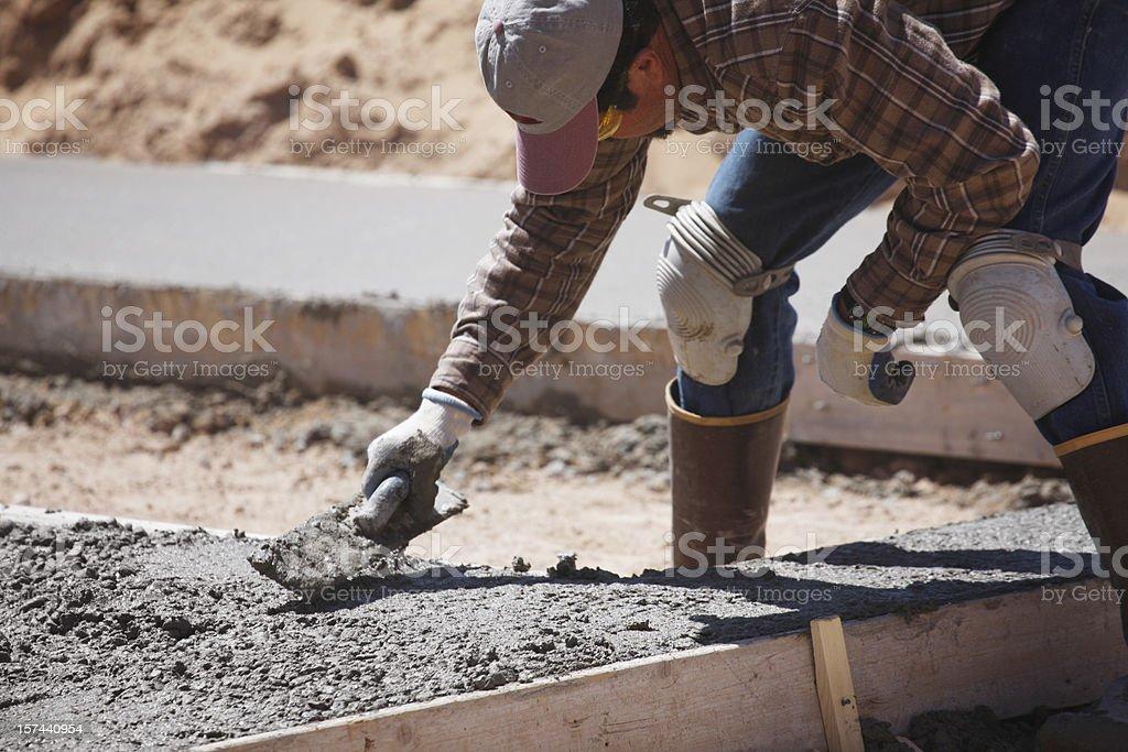 Man Doing Concrete Work stock photo