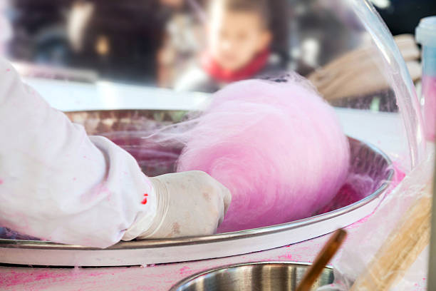Man doing cotton candy stock photo