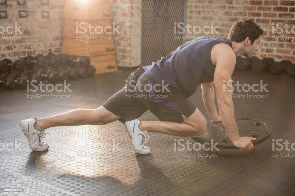 Man doing exercise with bosu ball stock photo