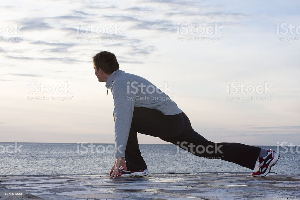 Man doing exercises at the sea royalty-free stock photo
