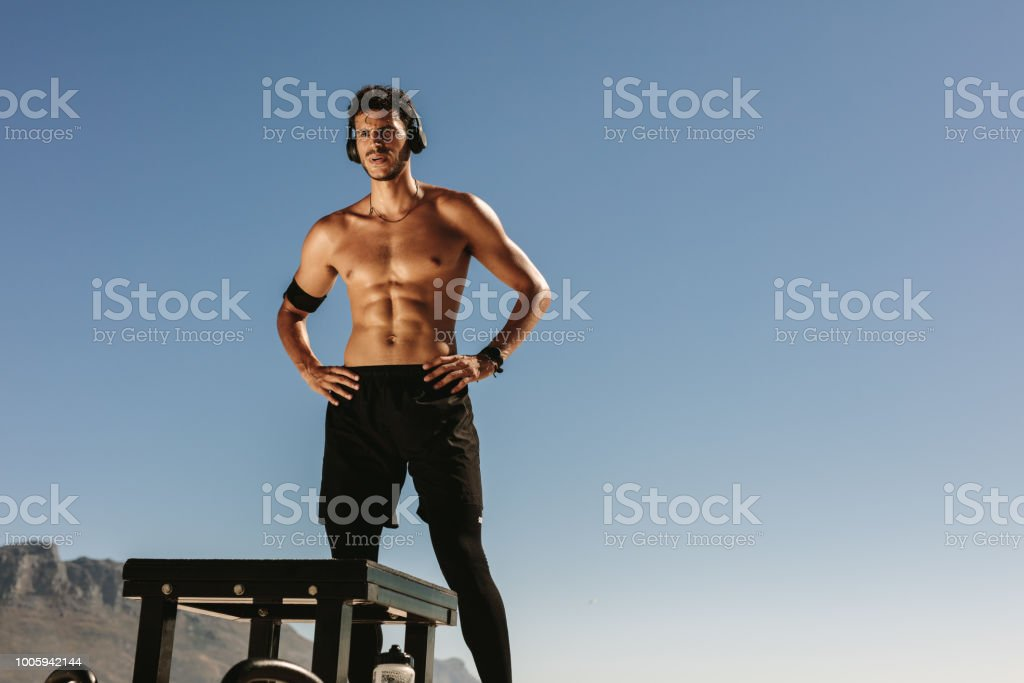 Man Doing Fitness Training At The Beach Listening To Music Stock Photo -  Download Image Now