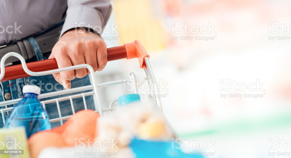 Man doing grocery shopping stock photo