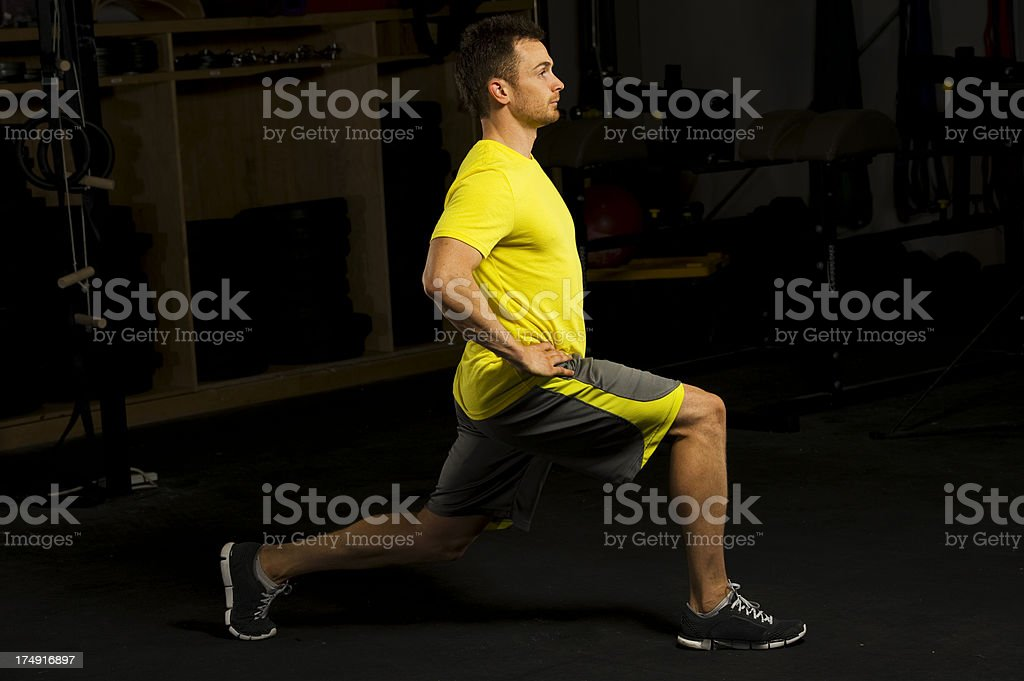 Man doing gym lunges stock photo