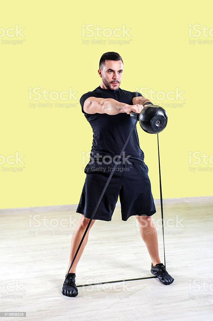 Man doing gym work out. stock photo