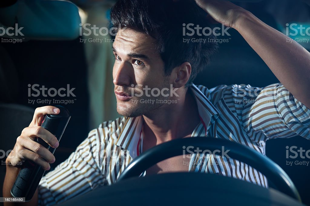 Man Doing Haircare In The Car stock photo