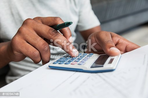 istock Man doing his calculations. 815234748