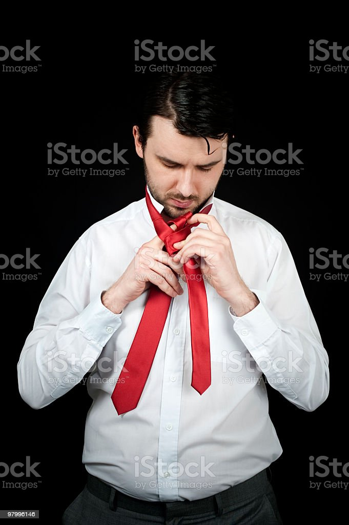 man doing his tie royalty-free stock photo