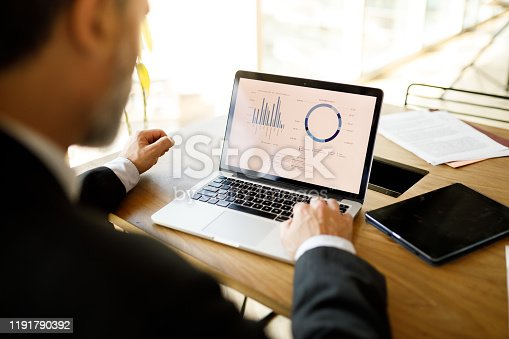 Businessman working on laptop at office.
